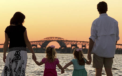 A family on the lakefront at sunset